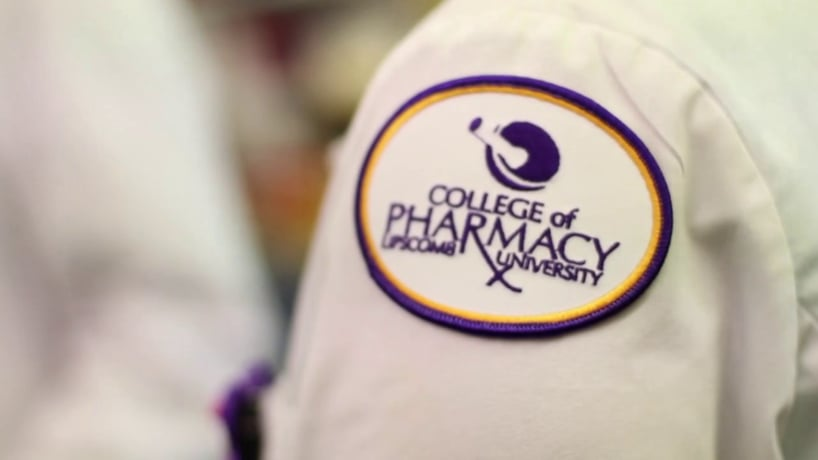 A student's College of Pharmacy badge is seen here.