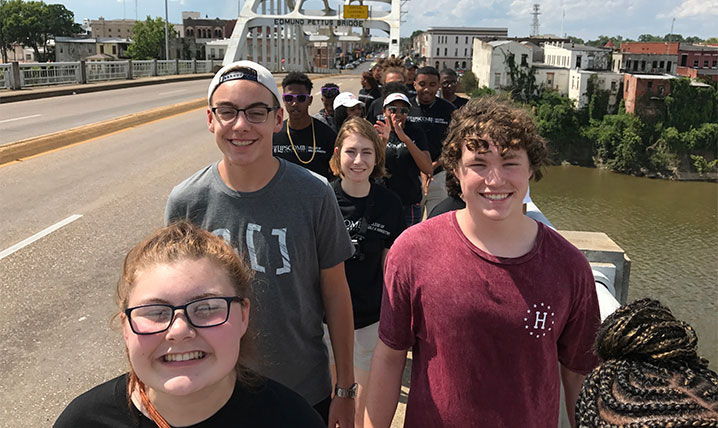 Students walk across the Edmund Pettus Bridge in Selma Alabama