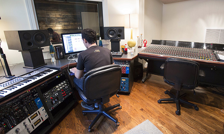 Student works in the Recording Studio of the Commercial Music department.