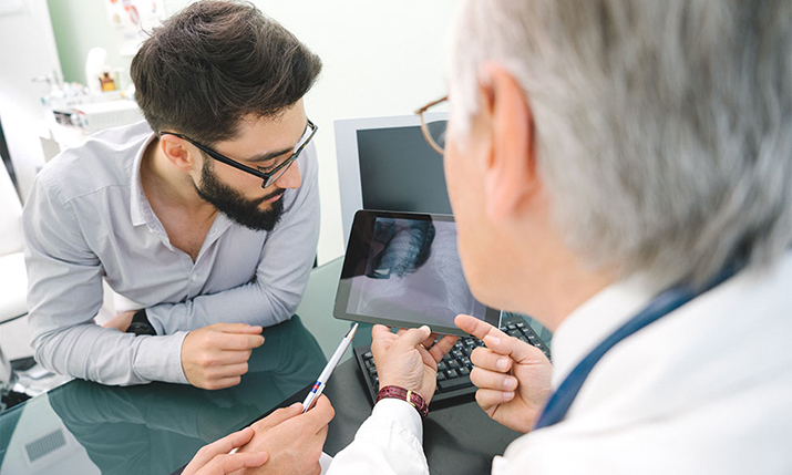 A PA consults with a doctor