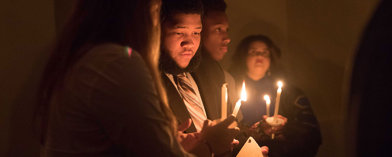 New students take part in Initium's candlelight ceremony