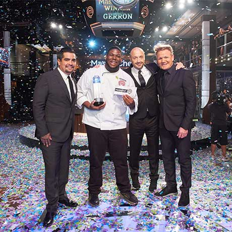Gerron Hurt stands with judges on Season 9 MasterChef competition.
