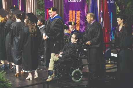 Seth Walker and Ken Brassell prepare to walk the stage at commencement