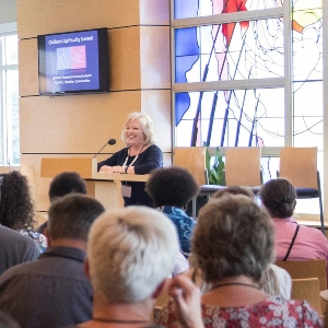 A woman speaks to a group of parents and ministers at the Children's Spirituality Summit