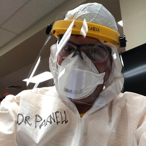 Dr. James Parnell dressed in personal protective equipment