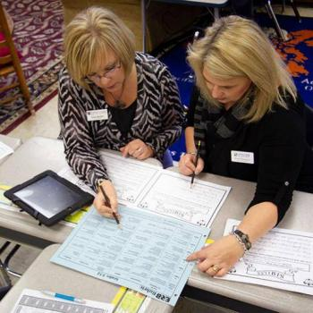 Two women doing lesson plans
