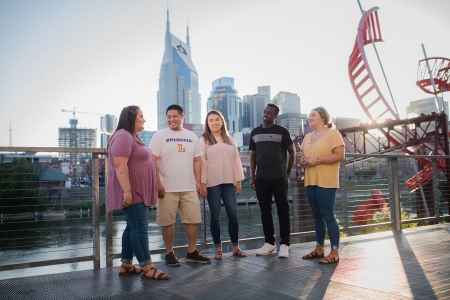 Students in front of the Nashville skyline