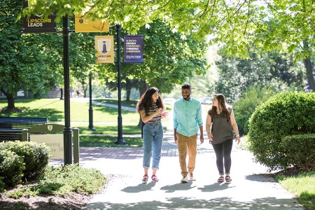Three students walking on the Lipscomb campus