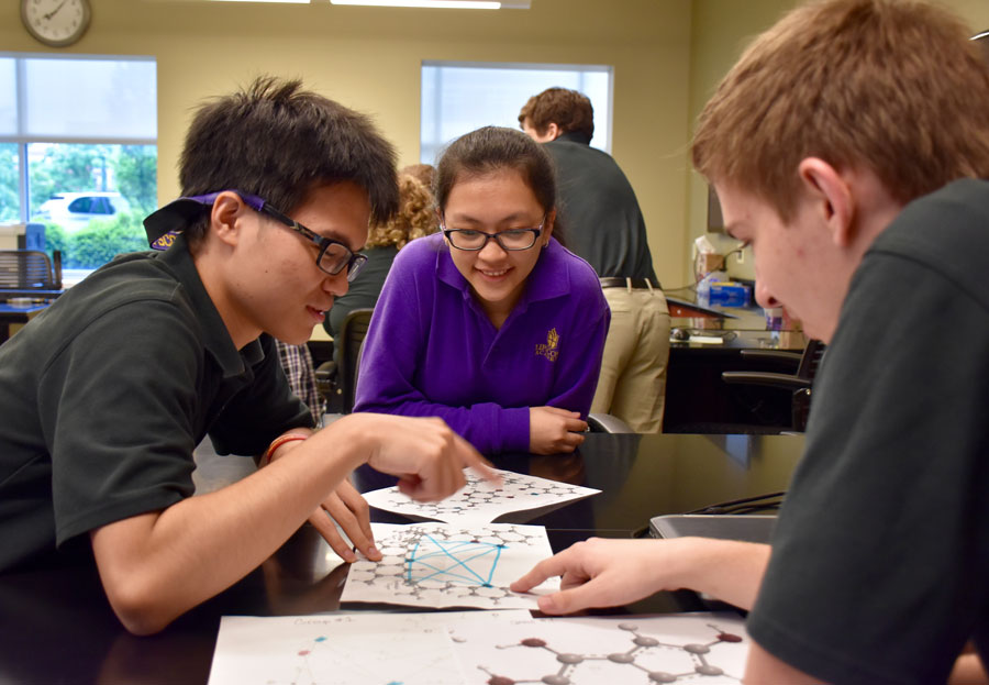 Lipscomb Academy students work on a project together