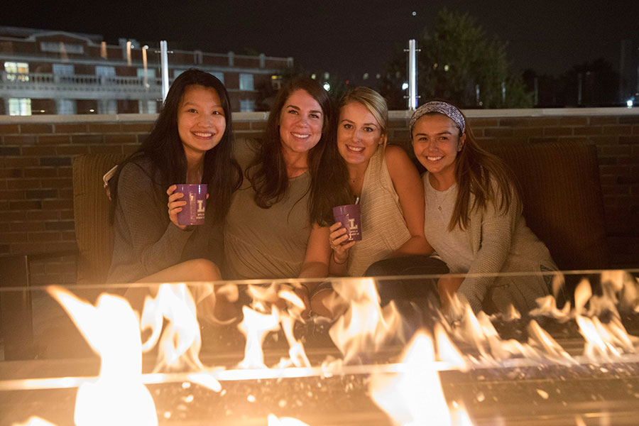 Students enjoy time together on the rooftop patio outside of Bison Café.