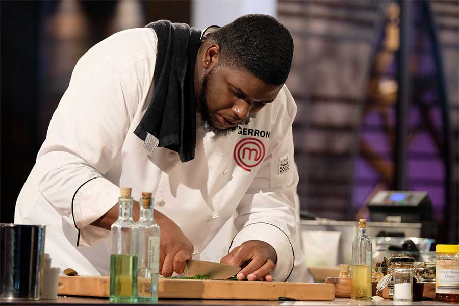 Gerron Hurt chopping herbs during the MasterChef season 9 finale.