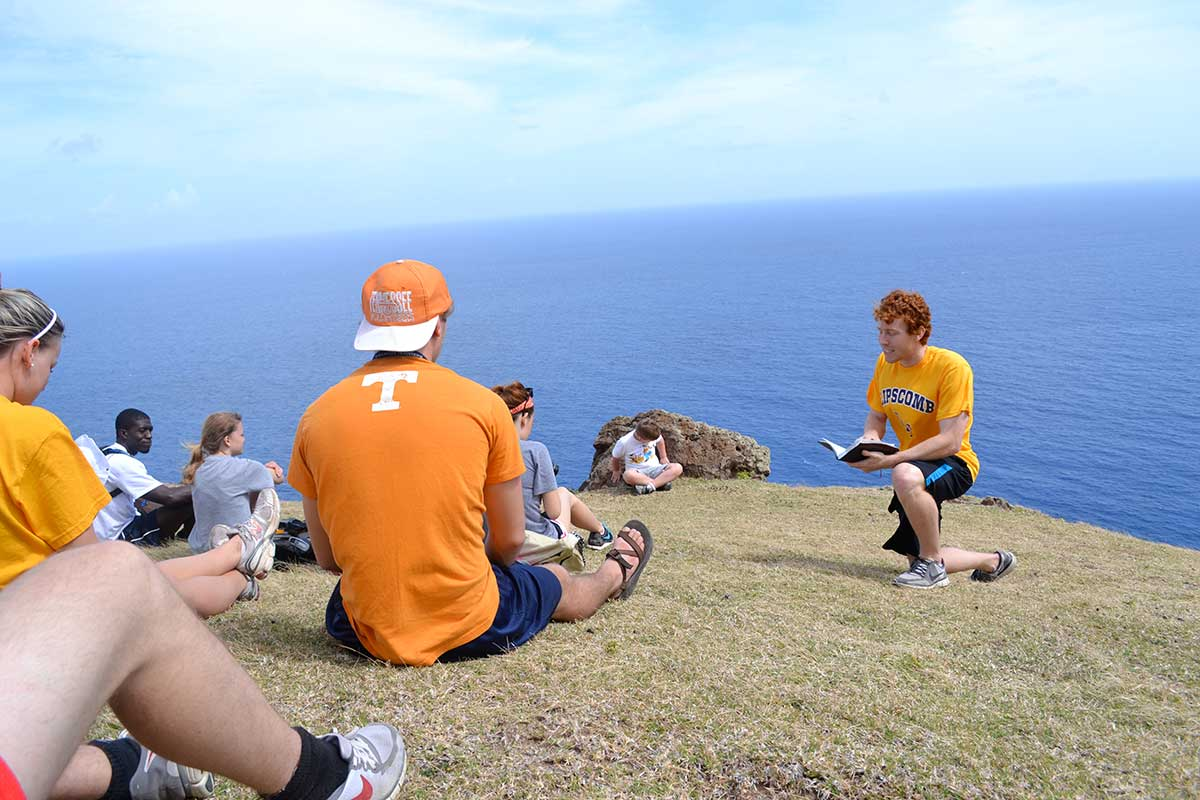 Students delve into the word while on mission.