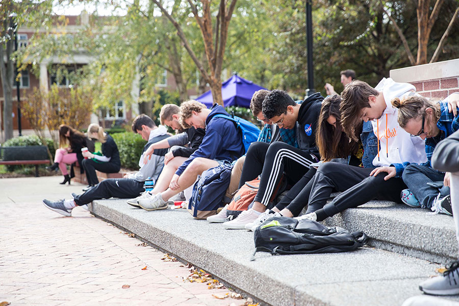 Students take part in a prayer vigil in Bison Square.