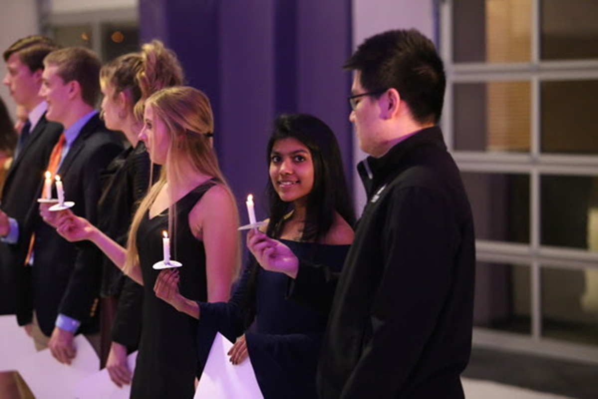 Global Students take part in a special ceremony with candles.