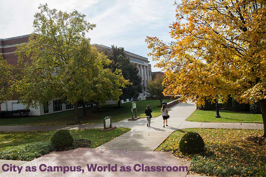 "Students walking on campus with the words ""City as Campus, World as Classroom"" superimposed."