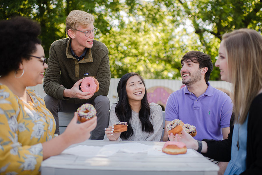 Five students enjoy Five Daughters Donuts in 12South