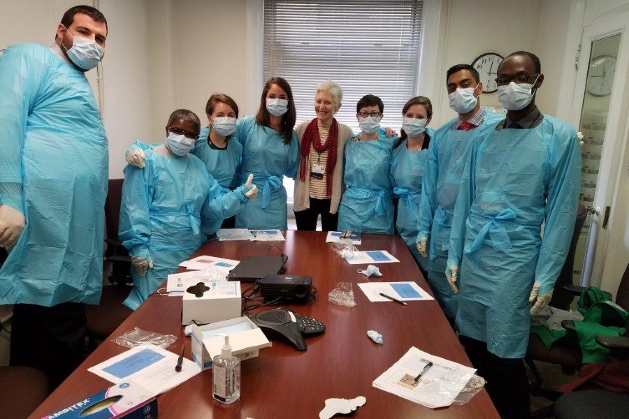 Kayla Ford with Lenox Hill interns in PPE