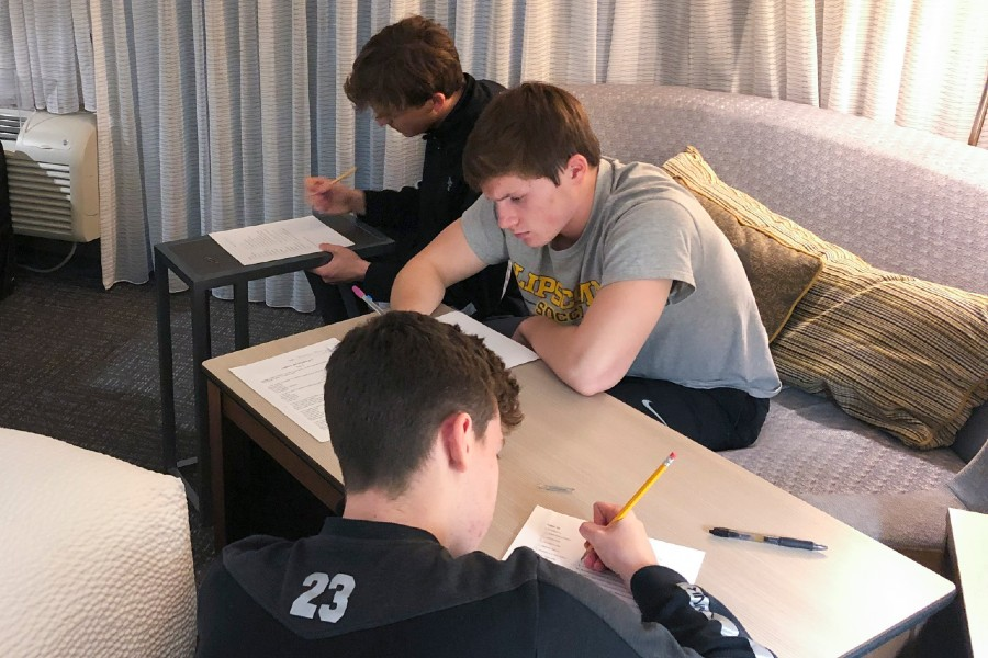 Athletes studying in hotel