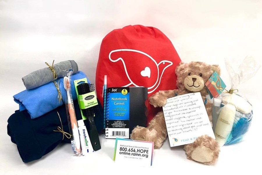 After care kit with items including teddu bear, tooth brush and other items.