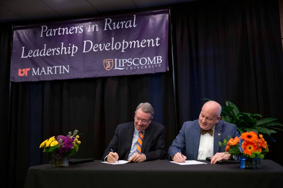 Lipscomb president Randy Lowry and UT Martin Chancellor Keith Carver signing agreement