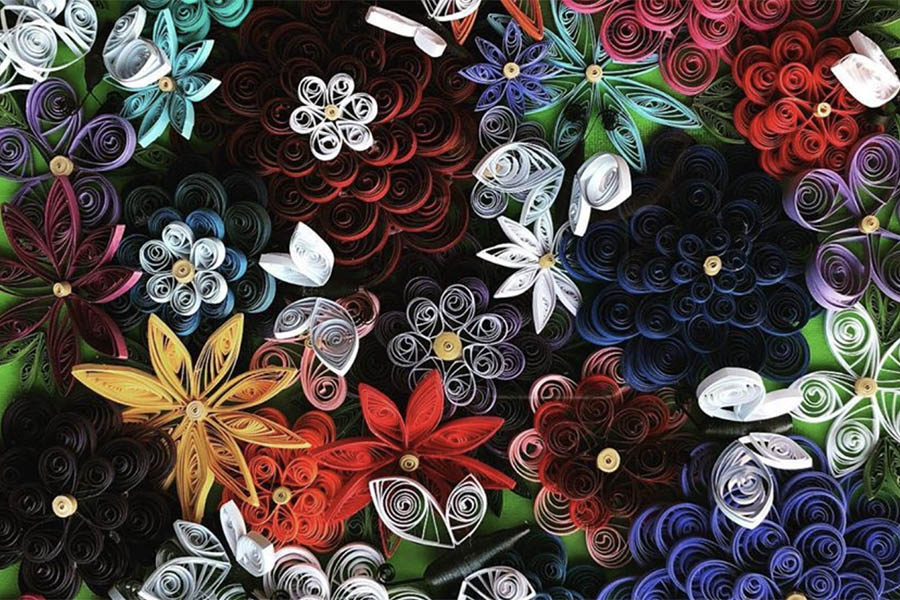 Quilled artwork of flowers and butterflies