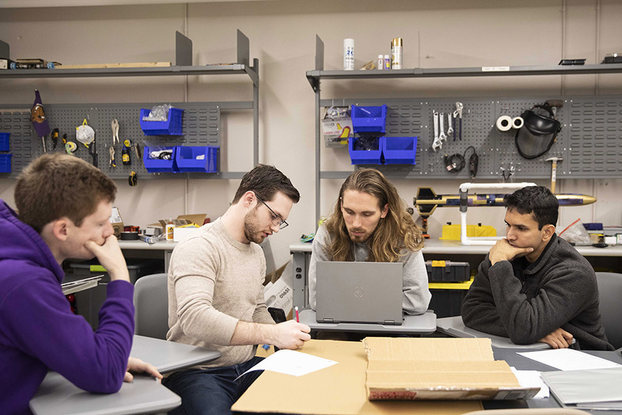 Engineering students work on the exoskeleton design in a Lipscomb lab