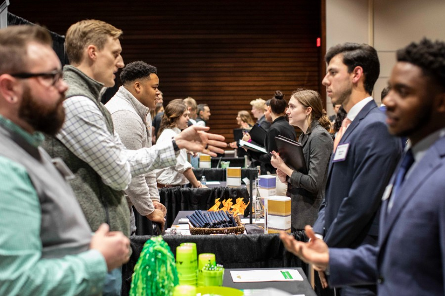 Students networking with employers