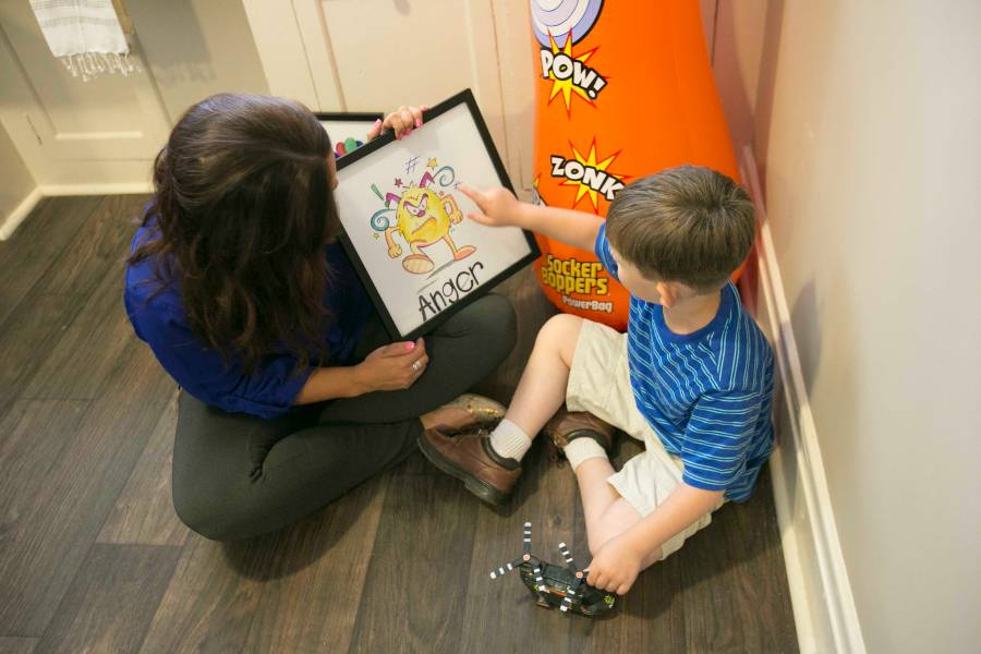 Counselor with student in play therapy setting
