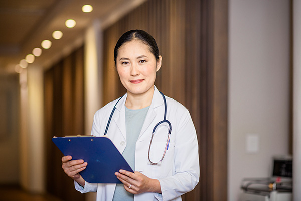 A health care professional with a clipboard and stethoscope.