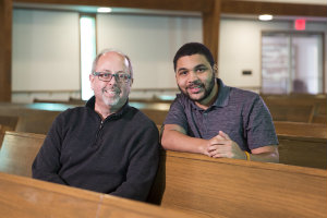 Randy Davis and LeBron Hill sit in pews at Wilson Avenue Church of Christ