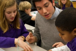 Student teachers interact with students in the classroom.