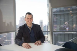 alum Chad Estep sitting inside the ETRADE office in New York City