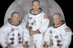 Apollo 11 astronauts in space suits.