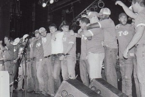 Photo of Tau Phi members standing on the stage