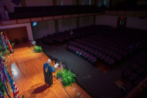 Lipscomb provost at graduation taping in empty Collins Auditorium