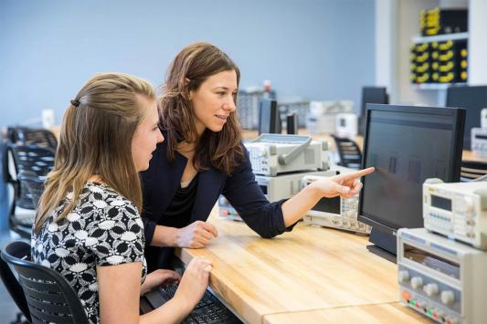 Stephanie Weeden-Wright, right, with student look at test output on a computer screen