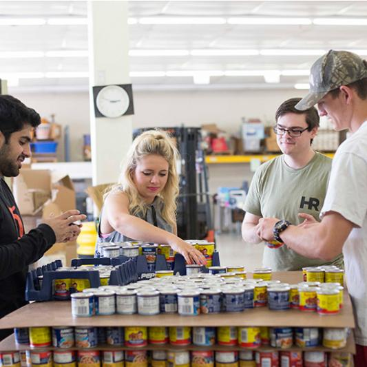 Students prepare cans of food for Service Day.