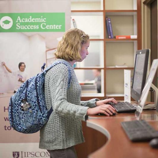 Student uses computer in Academic Success Center
