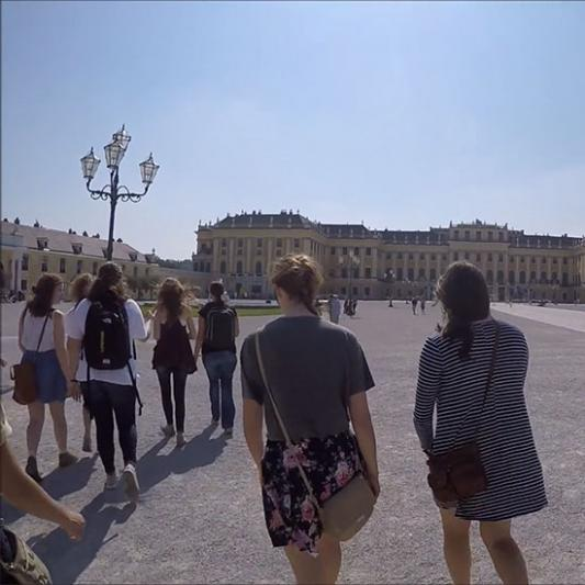Students walking outside near palace in Vienna, Austria
