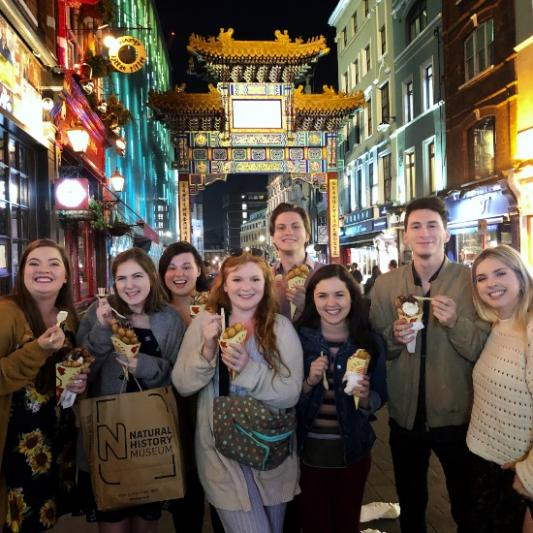 A group of students at the Chinatown Gate in London