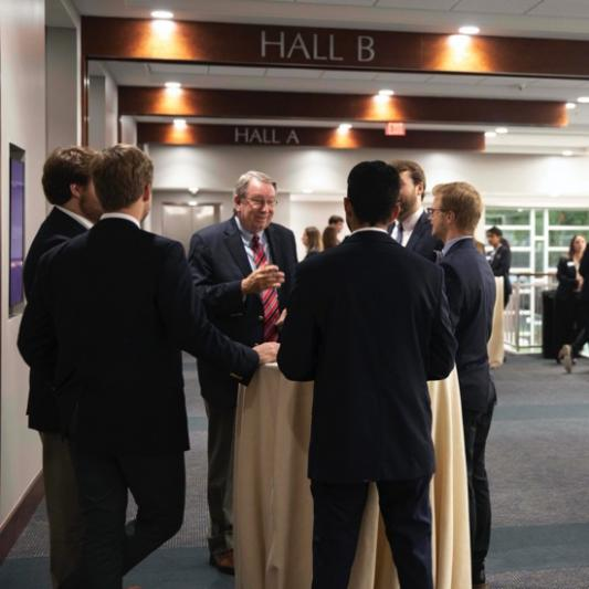 President Lowry speaking with students