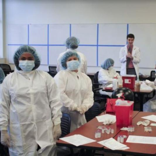 students in medical gear