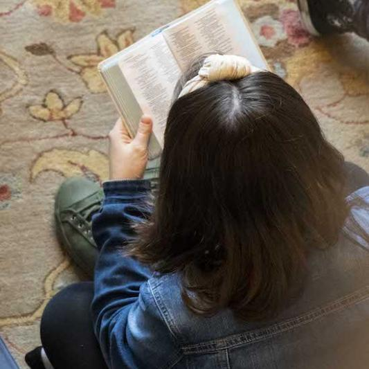 Student reads her Bible on a women's retreat.