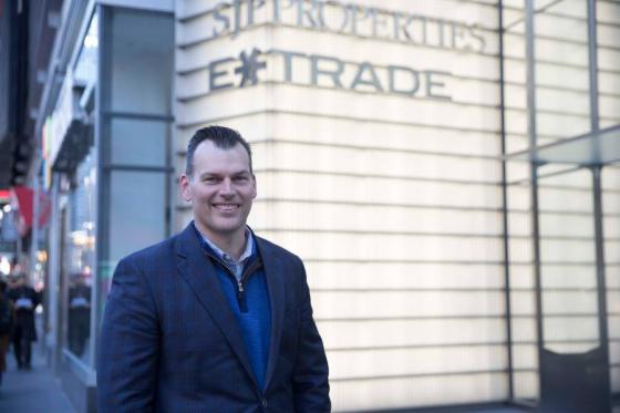 Chad Estep standing on the corner outside the ETRADE office in New York City.