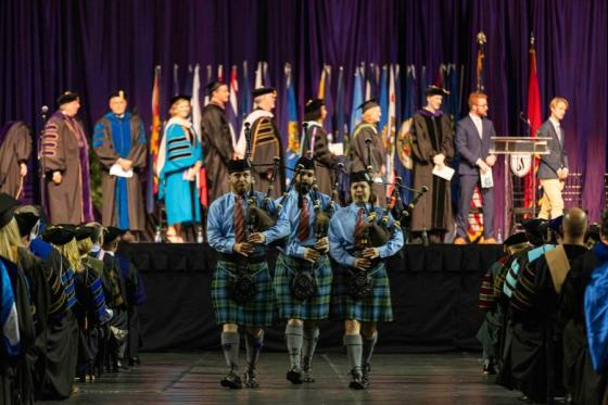 Three bag pipers marching at convocation
