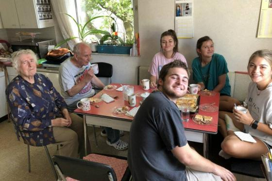 Students in Vienna at a table with residents of the city.