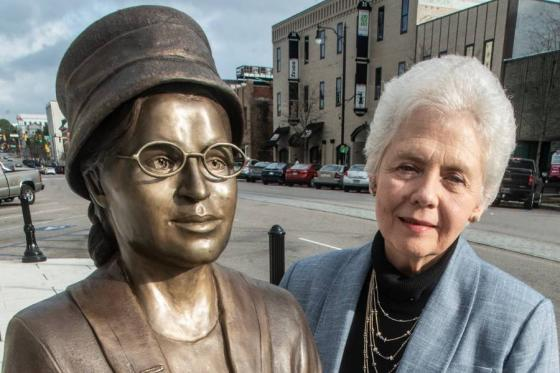 Artist Clydetta Fulmer with her statue of Rosa Parks.