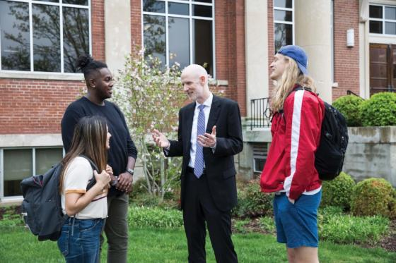 Student Life Dean Al Sturgeon speaks with student on the Lipscomb campus