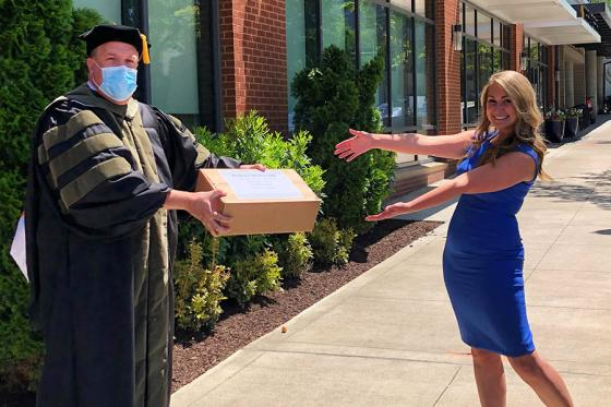 College of Pharmacy delivers gifts to a graduate in person