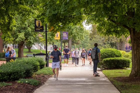 Students walking on campus wearing masks